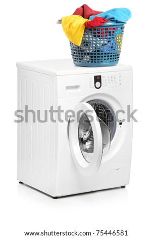 A studio shot of a laundry basket on a washing machine isolated on white background