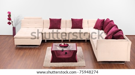 A studio shot of a modern white furniture decorated with pillows