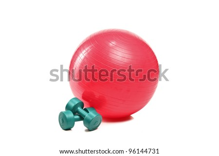 A studio shot of a pilates ball and dumbbells isolated on white background
