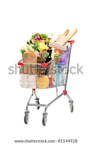 A studio shot of a shopping bag full with healthy groceries isolated on white background