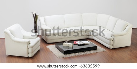 A studio shot of a white furniture, sofa and chair