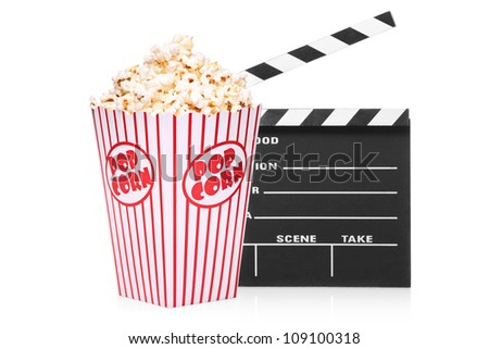A studio shot of an open movie clap and popcorn box isolated on white background
