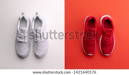 A studio shot of running shoes on bright color background. Flat lay. ストックフォト ©