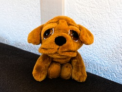 A stuffed toy in the shape of a dog