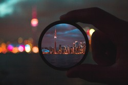 A stunning photo of a filter with the Toronto skyline in it