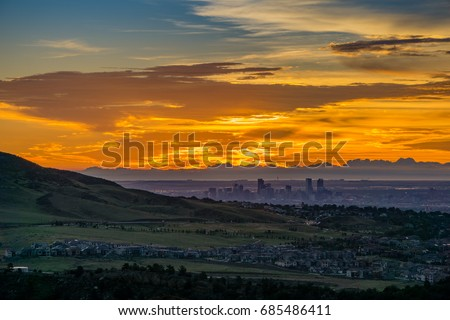 A stunning sunrise over Denver, as seen from Red Rocks Amphitheatre in Morrison, Colorado.