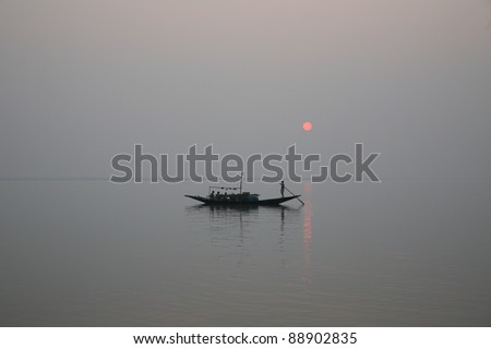 A stunning sunset looking over the holiest of rivers in India. Ganges delta in Sundarbans, West Bengal, India