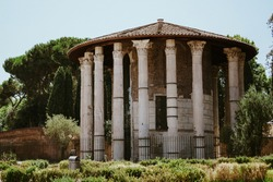 A stunning view of the famous Temple of Hercules Victor or Hercules Olivarius in Italy on a sunny day
