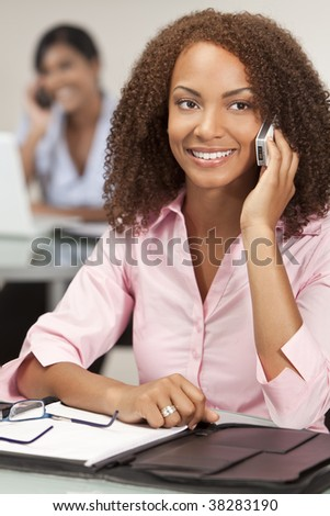 A stunningly beautiful young mixed race African American woman talking happily on her cell phone