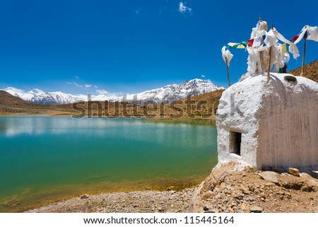 A stupa stands at the edge of a pristine mountain lake used by Buddhist pilgrims near Dhankar, Spiti Valley, Himachal Pradesh, India