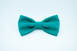 A stylish and well-designed green bow-tie on a white background; isolated