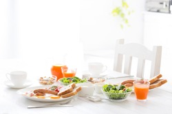 A stylish breakfast prepared on a white table