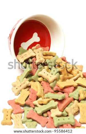 A stylish dog bowl spilling out the mans best friends treat.