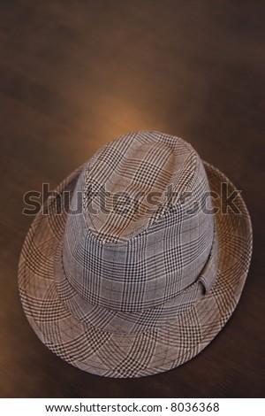 A stylish dress hat on a table.
