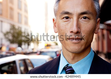 A successful business man in a street setting