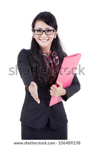 A successful business woman stretches out her hand to shake hands with someone