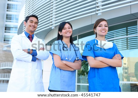 A successful man and woman medical team outside hospital building