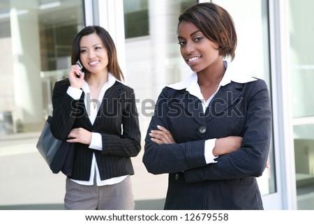 A successful, pretty, business team of diverse women - stock photo