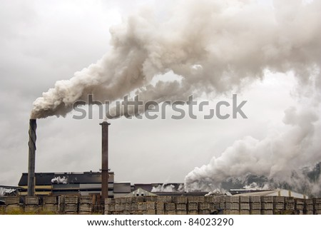 a sugar mill polluting the atmosphere with smoke and smog