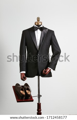 a suit worn by a mannequin Stock photo ©