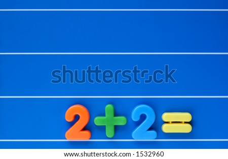A sum, from a child's toy number set, placed at bottom right of a blue, lined background. Space for text top left.