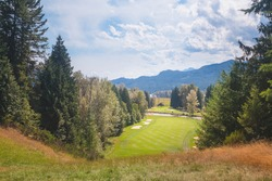 A summer day at Kokanee Springs Golf Resort golf course with view of Selkirk Mountains in Crawford Bay, British Columbia, Canada.