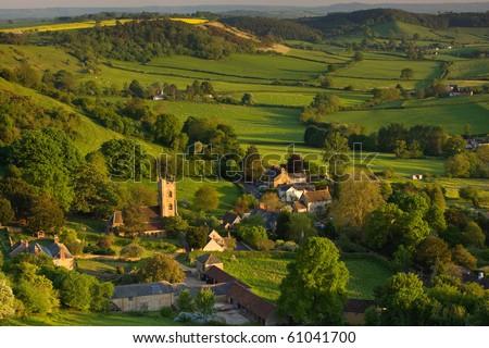 A summer evening view down onto the village of Corton Denham, Somerset, UK