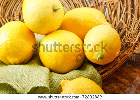 A summer still life with bright yellow lemons
