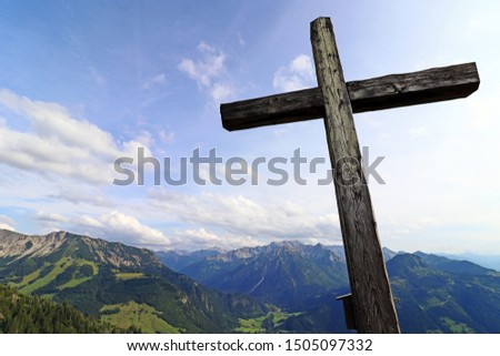 A summit cross in the Alps. A summit cross in the Allgaeu Alps. A summit cross in the evening light against the sky.   #1505097332