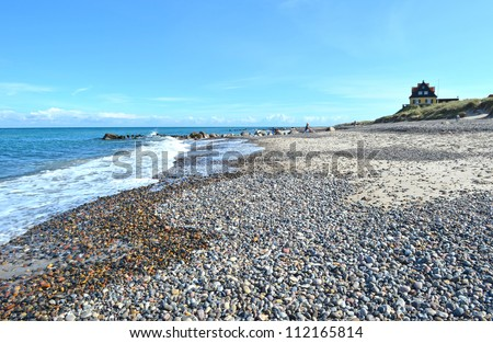 A sunny day during late summer on the beach next to Old Skagen in the northern part of Denmark