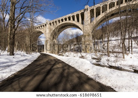 A sunny view of the underside of the historic stone arch New York, Susquehanna & Western Railway Martins Creek Viaduct in Pennsylvania.