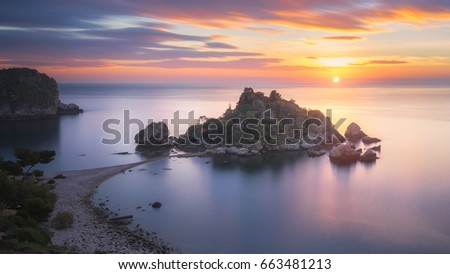 A sunrise captured at the famous location called Isola Bella in Sicily, Italy.
