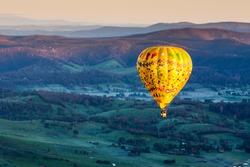 A sunrise hot air balloon flight over the Yarra Valley in Victoria, Australia