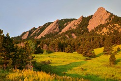 A sunrise photo of the Flatirons at Chautauqua Park in Boulder, Colorado