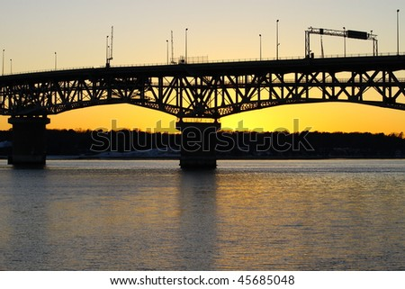 stock-photo-a-sunset-silhouetted-bridge-and-river-bank-at-sunset-45685048.jpg