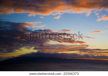 A Sunset view of Molokai taken from Maui Hawaii - stock photo