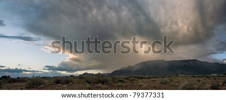 A supercell passes over Albuquerque's Sandia Mountains during monsoon season