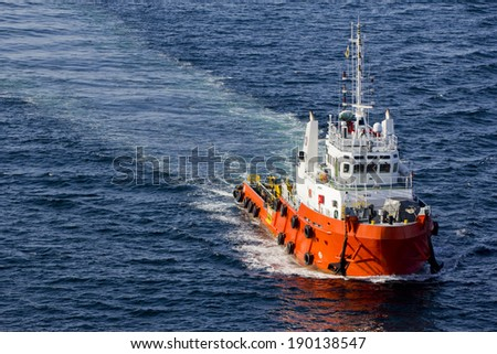 A supply boat in the midst of an open sea #190138547