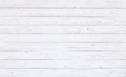 A surface of white worn out wooden boards in horizontal position. for vintage backgrounds, wedding invitations or spring motives
