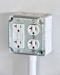 A surface run four plex eletrical outlet with GFCI protection.