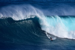 A surfer catches a massive wave at Peahi, also known as Jaws, off Maui's eastern shore.
