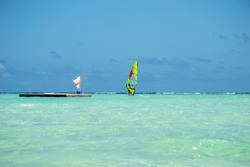 A surfer in the beautiful turquoise waters of Sorobon Beach Bonaire