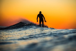 A Surfer riding waves in Long Island, New York