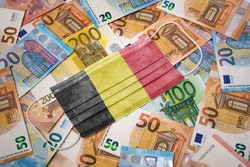 A surgical mask with the flag of Belgium on a variety of european banknotes.(series)
