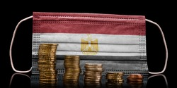A surgical mask with the flag of Egypt behind some descending stacks of various coins.(series)