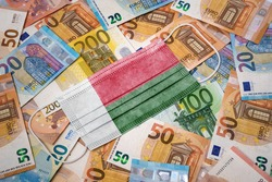 A surgical mask with the flag of Madagascar on a variety of european banknotes.(series)