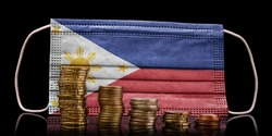 A surgical mask with the flag of Philippines behind some descending stacks of various coins.(series)
