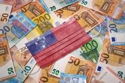 A surgical mask with the flag of Samoa on a variety of european banknotes.(series)