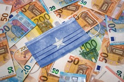 A surgical mask with the flag of Somalia on a variety of european banknotes.(series)
