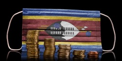 A surgical mask with the flag of Swaziland behind some descending stacks of various coins.(series)